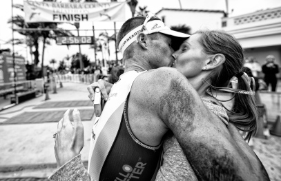 ©Kevin Steele's image of a triathlon winner and his spontaneous hug as he crosses the finish line. They were engaged, married 6 months later and used this image as their wedding invitation.